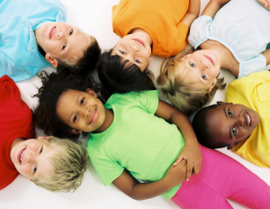 Children laying down in a circle.